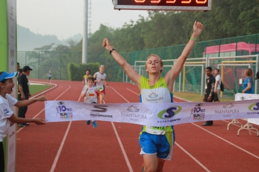 Phuket marathon runner crossing finish line. JPMestanza.com